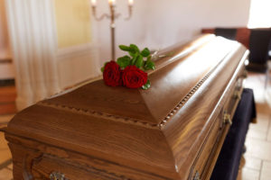 funeral services coffin with red rose