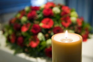 funeral ceremony flowers and candle